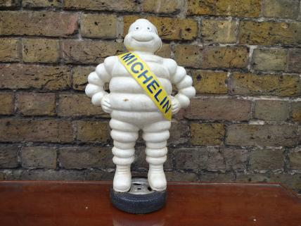 Michelin Man Standing On Tyre