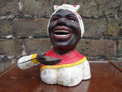 Negro woman with red scarf moneybox