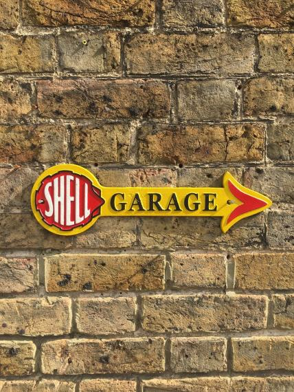 Shell garage arrow sign