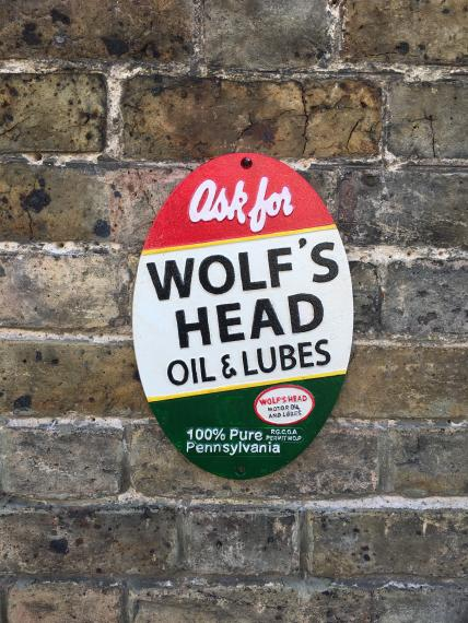 wolfs Head oil plaque