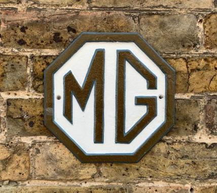 brown MG wall plaque