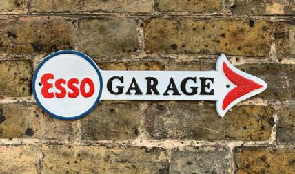 Esso garage arrow sign