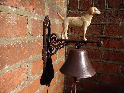 Standing dog bell -white