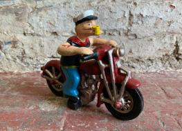 Popeye figure on motorcycle