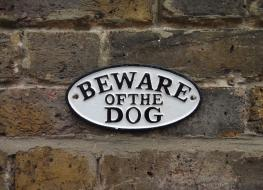"small ""Beware of the Dog"" sign"