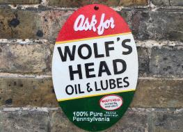 wolfs Head oil plaque
