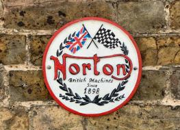 round Norton wall plaque