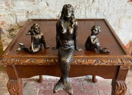 3 small mermaid figures