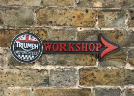 Triuph workshop arrow sign