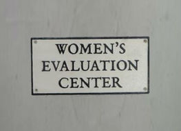 Women's evaluation centre sign